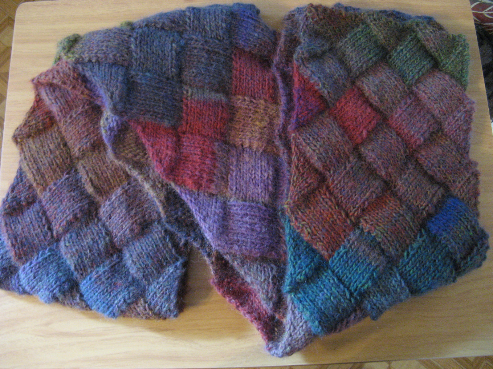 Knitting update entrelac scarf is done bead yarn spatula which leads me to what is currently on my knitting needles a shrug granted right now it doesnt look like much but once i get all 40 plus inches knitted bankloansurffo Gallery